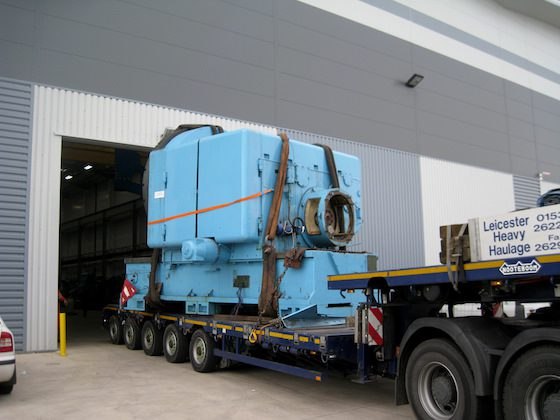 Heavy machinery leaving the factory for the last time, heading for a new home
