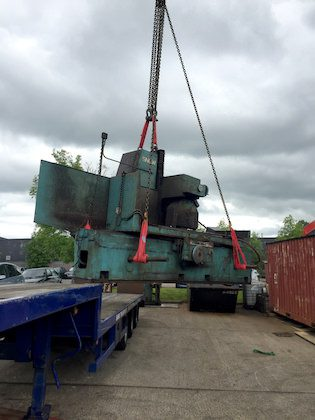 Lifting heavy machinery for factory relocation