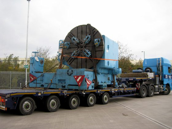 Heavy machinery carried by lorry for factory relocation