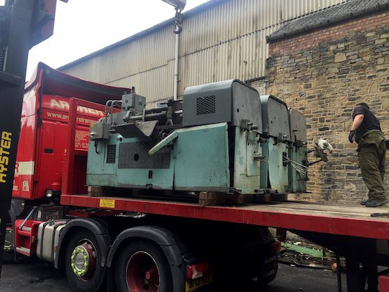 Heavy industrial machinery secured on lorry, being taken for export