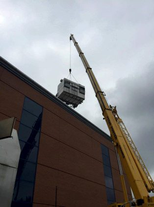 Moving specialist machinery by crane